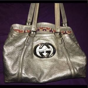 Authentic Gucci metallic silver GG logo handbag